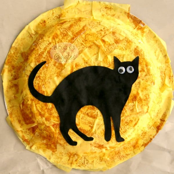 "black cat against a paper plate ""moon"""