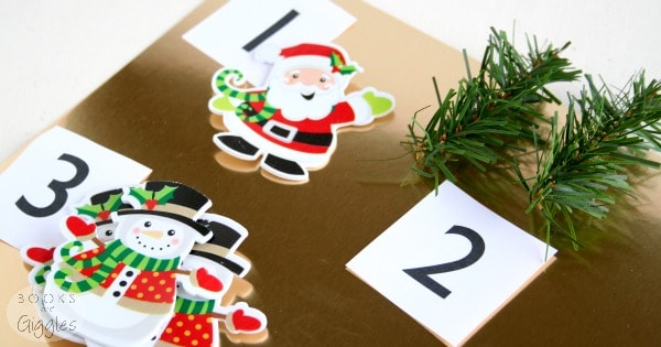 A simple, hands-on activity for toddlers or young preschoolers to do after being read The Very Hungry Caterpillar's Christmas 123 board book