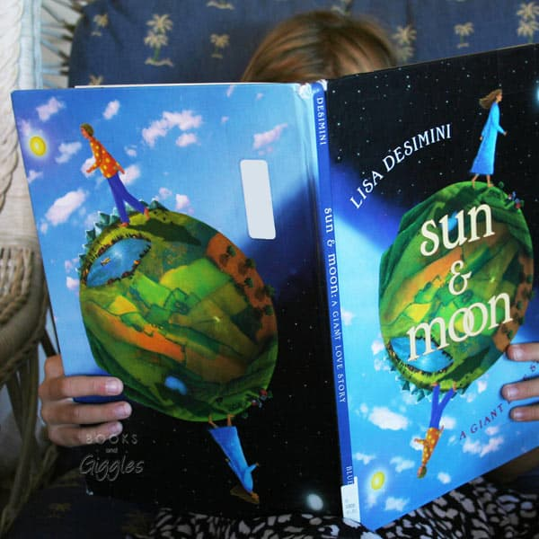 reading an eclipse story from the list of solar eclipse books for kids