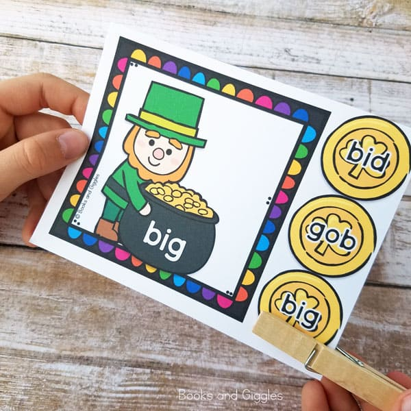 Child's hands using a St. Patrick's day leprechaun themed printable sight word activity