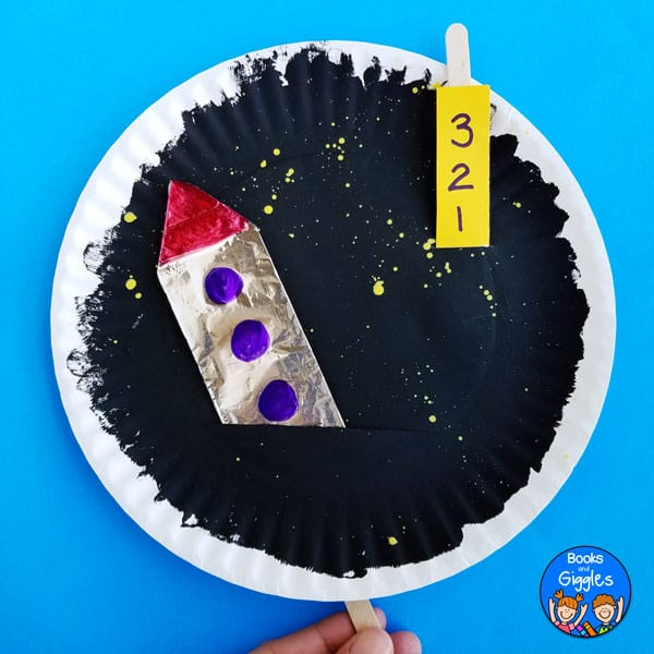 Interactive paper plate rocket craft that lets kids count down to blastoff, and then pretend their rocket is soaring into space
