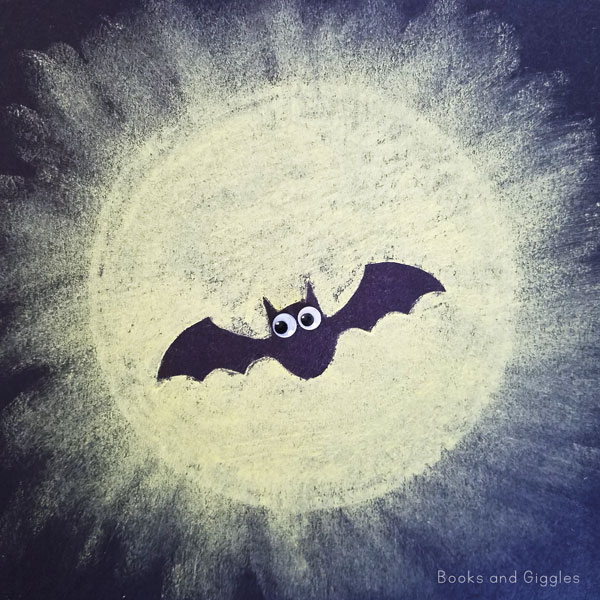 "This is an easy bat craft preschool kids will love! They can strengthen fine motor skills and ""magically"" create a bat silhouette against a glowing full moon."