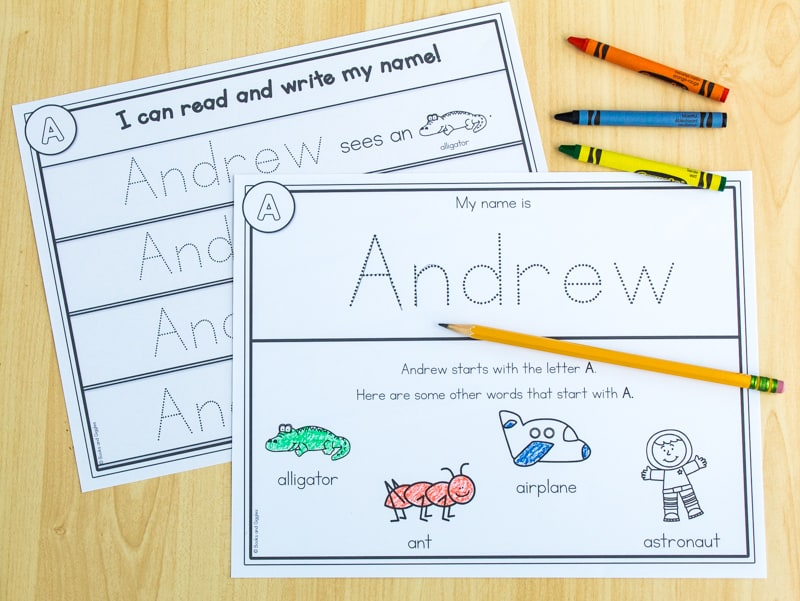 partly filled out name tracing worksheets with crayons and pencil