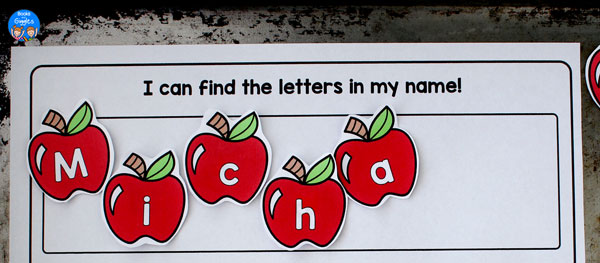 apples spelling out a name, stuck with magnets onto a cookie sheet