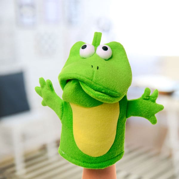 Frog puppet making a sort of sad face