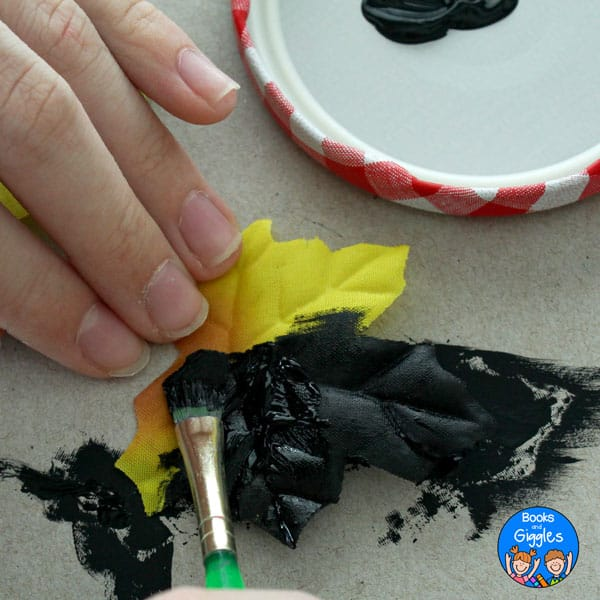 fabric leaf being painted with black paint