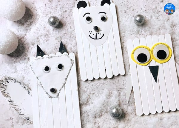 popsicle stick arctic animal crafts showing an arctic fox, polar bear, and snowy owl