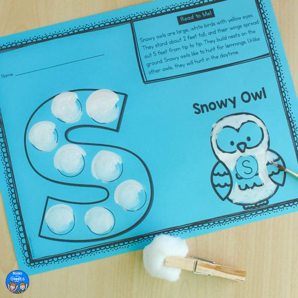 s is for snowy owl worksheet printed on blue paper shown with white paint dabbed on with a cotton ball held by a clothespin