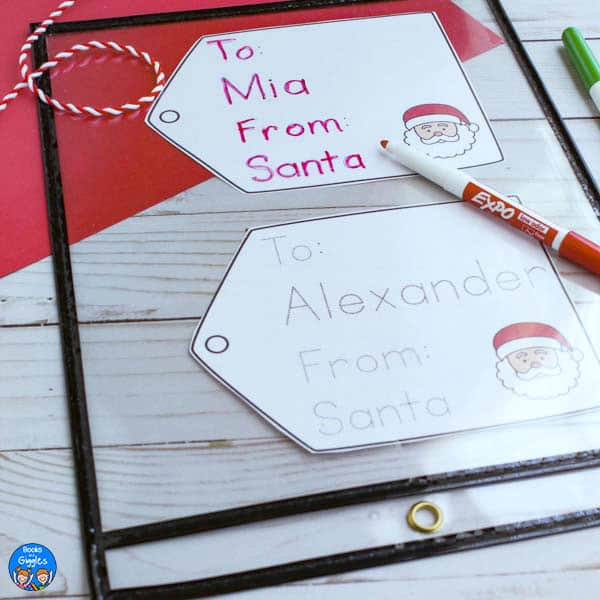 printed Christmas name tracing in a sheet protector with a dry erase pen