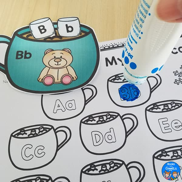 dot marker held over hot cocoa letter sounds worksheet and activity card