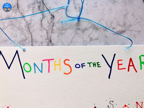closeup showing ribbon tied onto months of the year craft