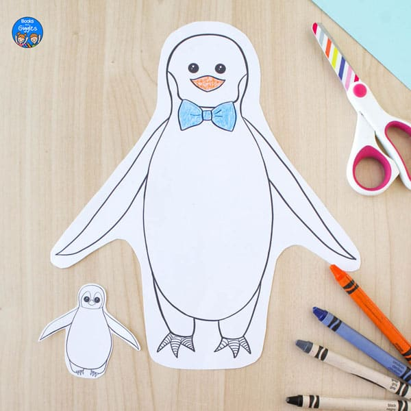 printed penguin craft with dad and chick cut out and partly colored in