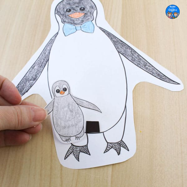 craft with hand holding chick up next to dad and small magnet