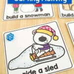card showing a polar bear riding a sled, marked with a snowflake mini eraser