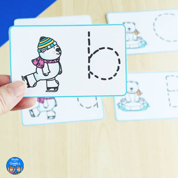 hand holding a letter tracing card with lowercase letter b