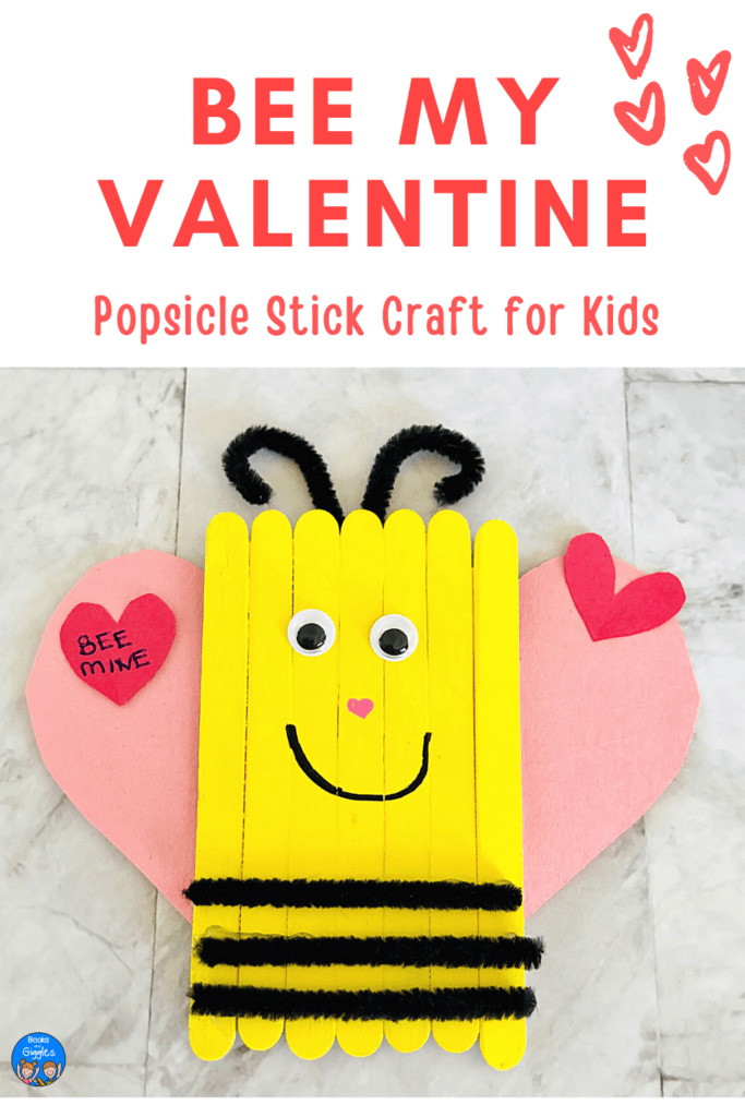 """""""Bee My Valentine Popsicle Stick Craft for Kids"""" with the Valentine's Day Bee craft on a white background. The wing of the bee has a heart that reads """"bee mine"""""""