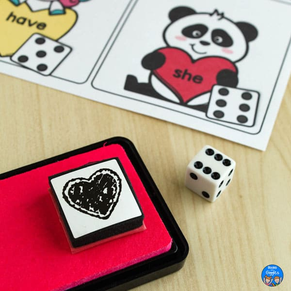 corner of printable with panda, heart stamp on stamp pad, and a dice