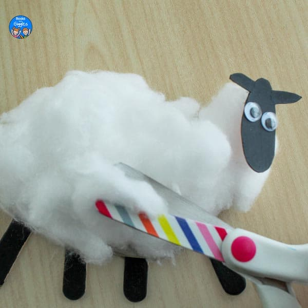 "closeup of colorful striped scissors ""shearing"" the sheep craft"