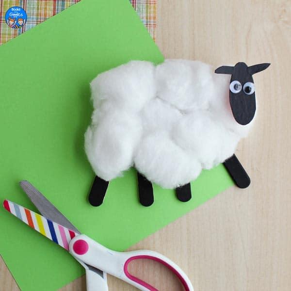 cotton ball sheep craft next to scissors