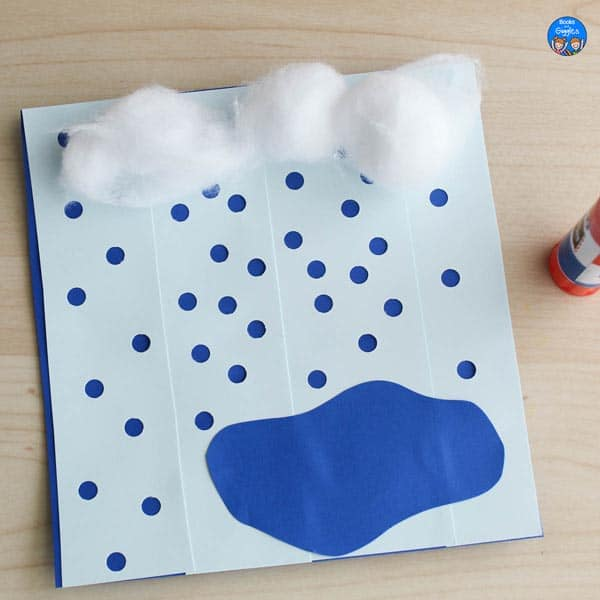 rain craft with hole punched rain, a puddle, and cotton ball clouds