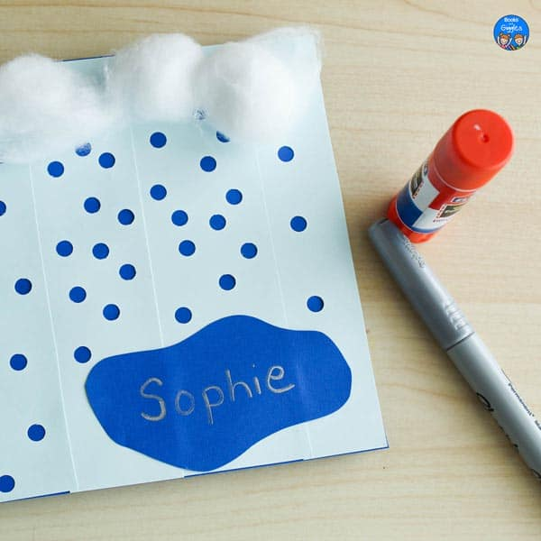 rain craft with hole punched rain, a puddle with a name written on it, and cotton ball clouds