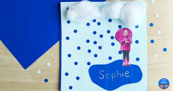 rain craft with hole punched paper surrounding it