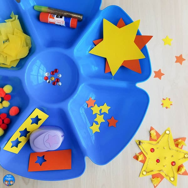 closup of blue plastic sectioned tray containing materials for preschool sun crafts