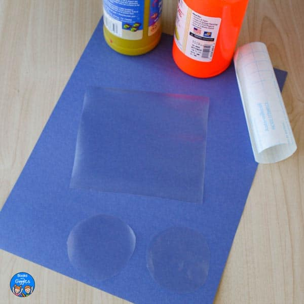 2 clear plastic circles and a clear plastic square laid out ready to prep the sun craft