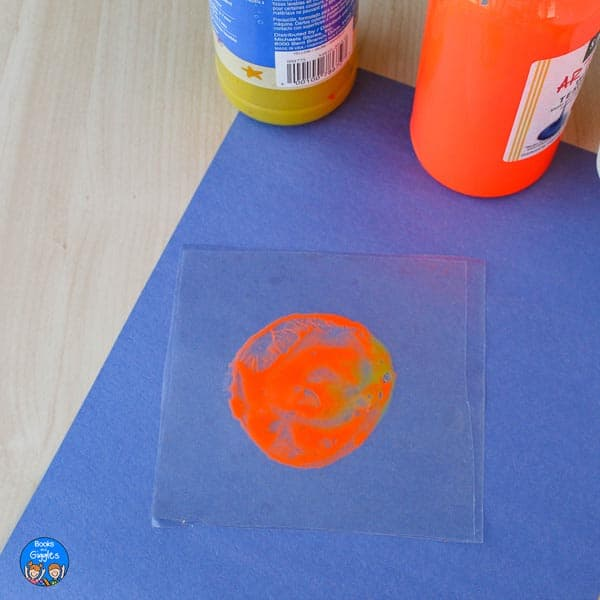 partly mixed paint in a sealed circle