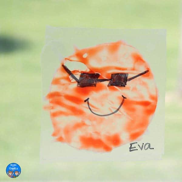 "sun suncatcher craft with a child's name ""Eva"" written on it"