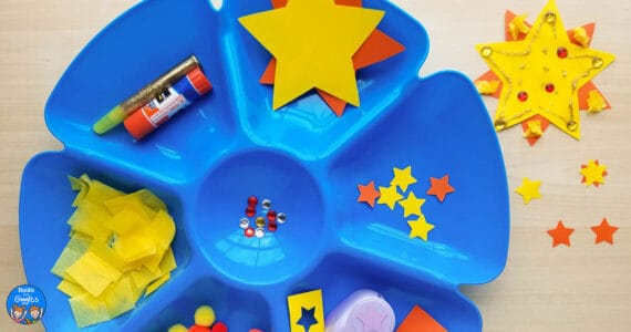 blue sectioned tray containing sun craft preschool art materials