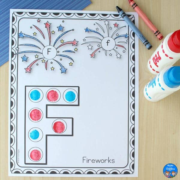"""red and blue do-a-dot markers next to a letter F worksheet about the word """"fireworks"""""""""""
